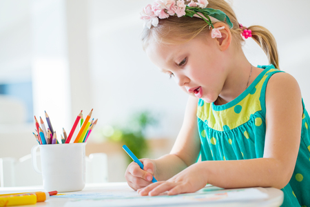 drawing room: Little girl draw at the table Stock Photo