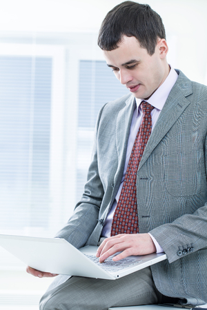 expertise: businessman with laptop in office