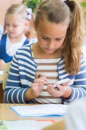 industry: schoolchildren sit at their desks in elementary school