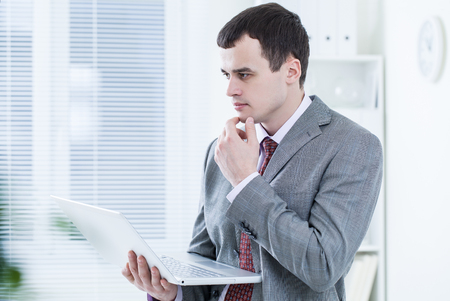 businessman with laptop in office photo