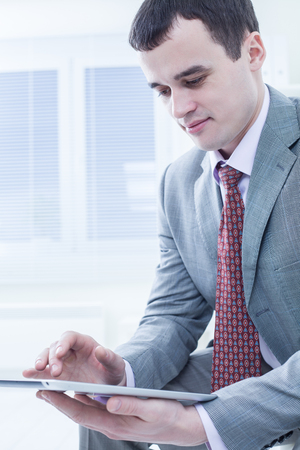 businessman with tablet in office photo