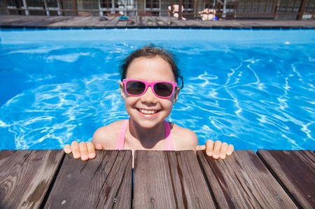 portrait of  little girl by the side of the pool Stock Photo