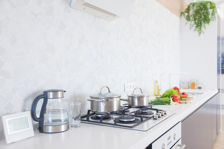 attic: Modern kitchen at home with kitchenware Stock Photo