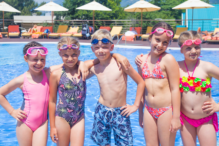 Children play in swimming  pool at the sea resort