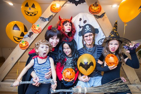 big  family in costumes has fun in her house in halloween Stock Photo