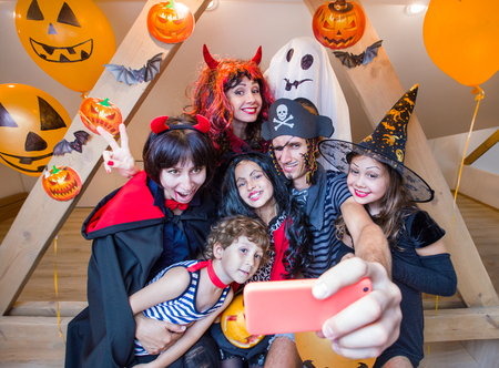 Big family makes selfie in halloween costumes