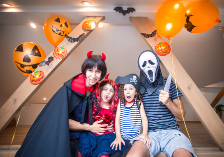 family in costumes has fun in her house in halloween Stock Photo