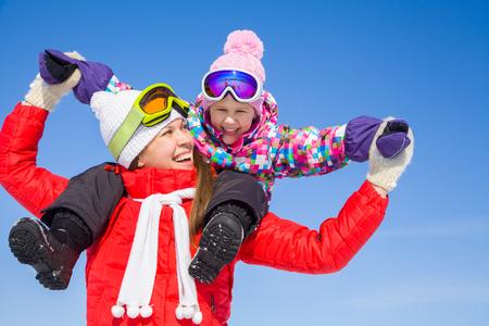 ski walking: Portrait of smiling woman with cute little girl in wintertime