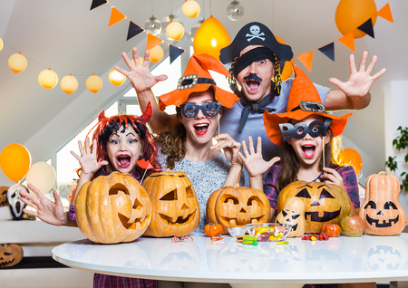 happy family celebrates halloween at home.