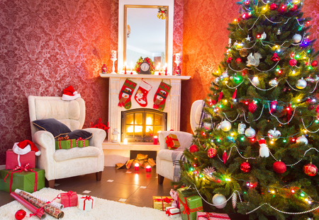 Festively decorated apartment with fireplace and Christmas tree
