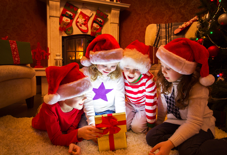 Group of four children with presents on Christmas party Banque d'images