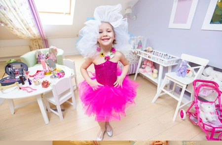 portrait of  little cute ladies fashionista in childrens room