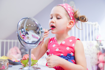 little girl fashionista doing makeup in the childrens room