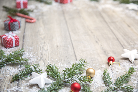 beautiful Christmas picture with branches of a Christmas tree, gifts and New Years ornaments Stock Photo