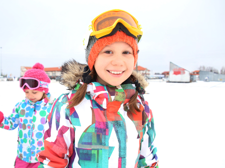 Portrait of two little girl skiing  in winter resort Stock Photo