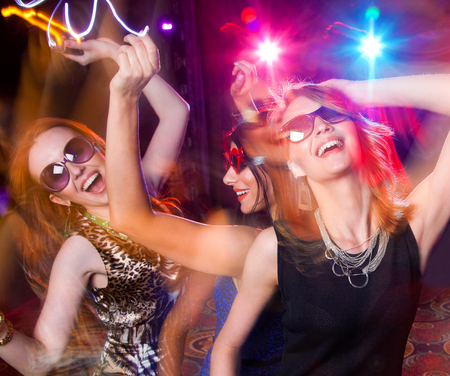 Group of young people having fun dancing at  party. Stock Photo