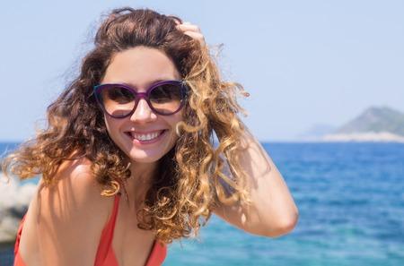 Portrait of young pretty woman having good time on sea. Bikini. Beach.