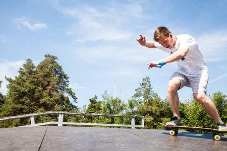 Young Skater riding at skateboard in skate park