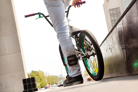 young  boy  with his BMX Bike at the skate park Stock Photo