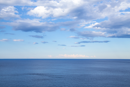 beautiful view of the horizon in a calm sea with clouds Stock Photo