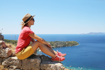 young woman enjoys beautiful see on the sea in summer vacation