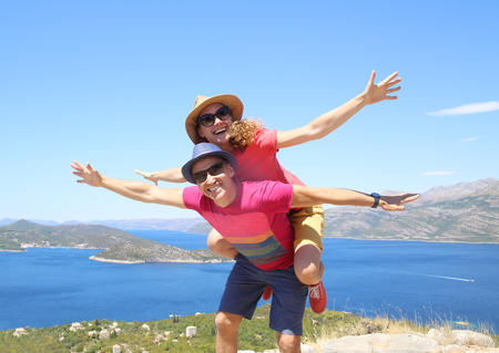 young couple taveling into the mountains on summer vacation