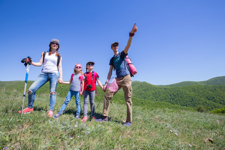portrait of a family in a hike through the mountains