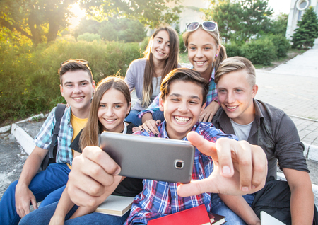 group of teenagers in the park do selfie Stock Photo