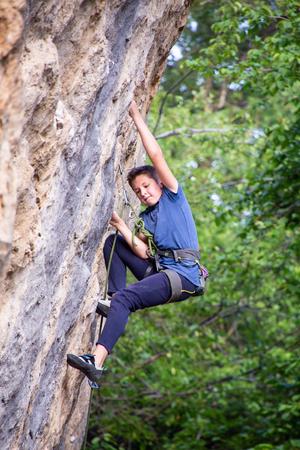 rock climber climbing an overhanging cliff