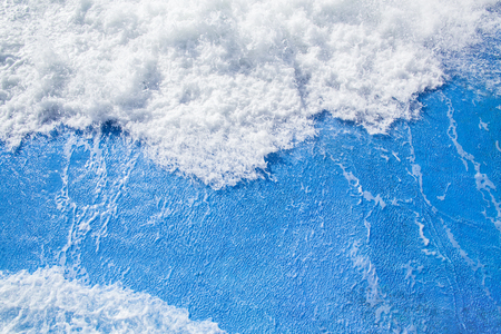 big wave with foam rolls to the sea shore Stock Photo