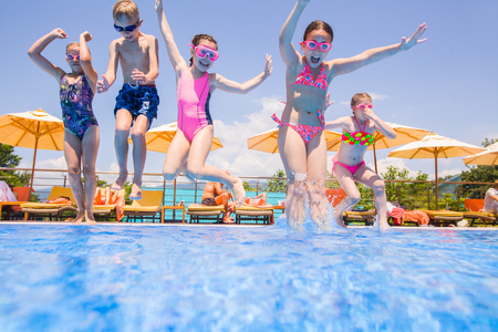 Children play in pool at the resort Imagens