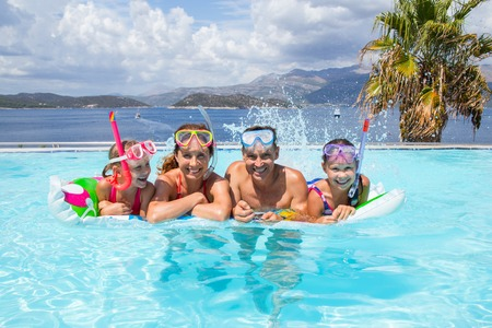 Portrait of big family  swimming in  pool on sea resort Stock Photo