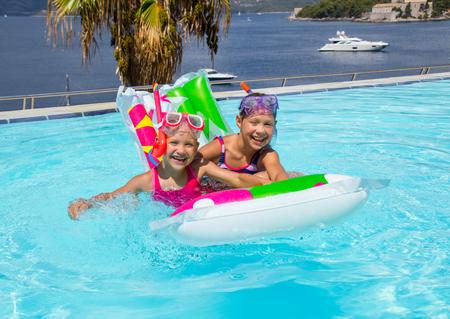 Portrait of little girls  swimming in  pool on sea resort