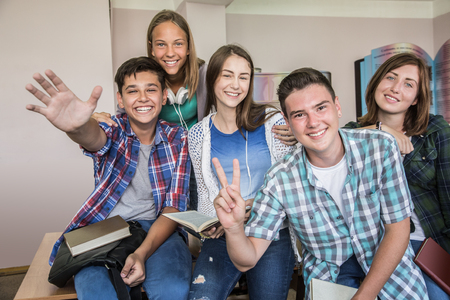 group of students sitting in the classroom at school Stock Photo