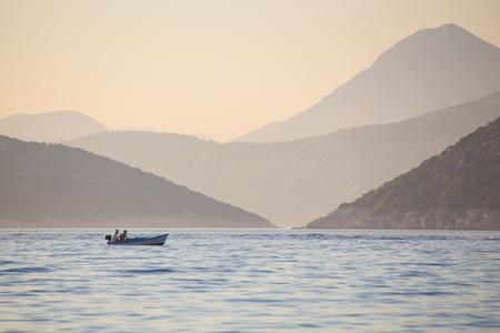 beautiful view of the mountainous coast in a calm sea Stock Photo