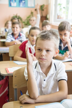 group of children learning on classroom in school Stock Photo