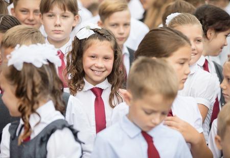 portrait of big group of primary school children outdoor in forms