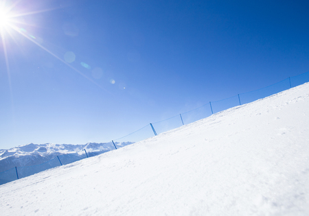 empty ski slope of the snowy mountains in a winter resort Stock Photo