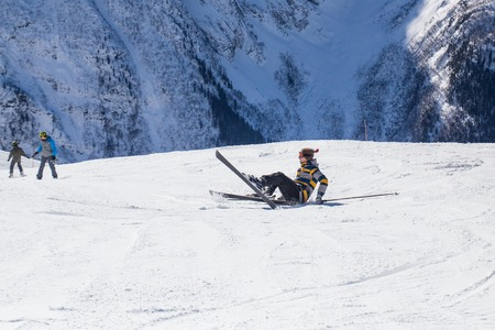 young man learning to ski at the ski resort