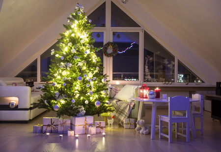 festively decorated home interior with Christmas tree Stock Photo