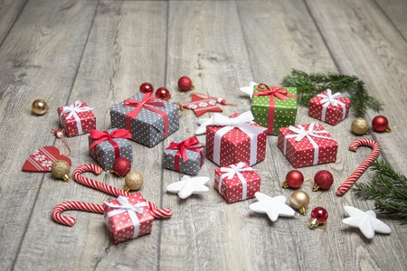 beautiful set of Christmas accessories - Christmas tree branches, gifts, decorations on the wooden floor