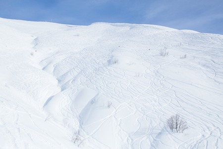 empty ski slope of the snowy mountains in a winter resort Banco de Imagens