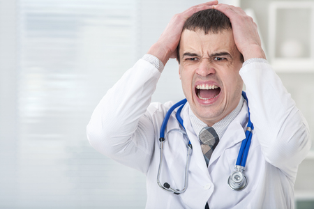 Portrait of male doctor having  stress Stockfoto