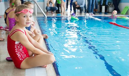 little swimmer girl in swimming pool