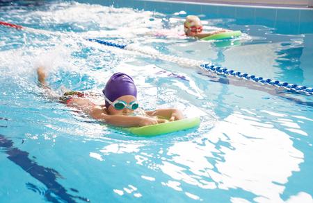 little  girl swimming in blue  pool