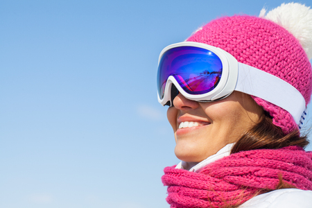 portrait of young smilling woman  on winter holiday outdoor