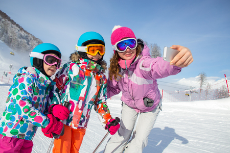 Family makes self-portrait phone in gear at a ski resort