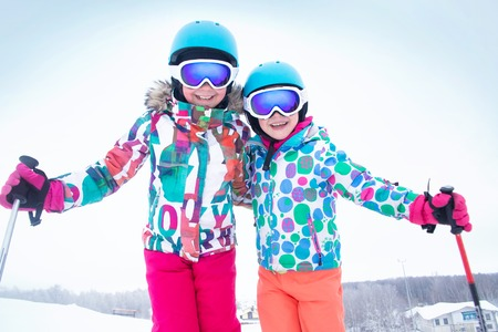 portrait of little girls skiing  to ski slope  in the winter  mountain resort