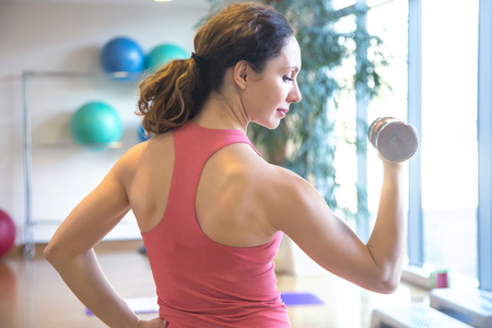 young beautiful woman training  in gym