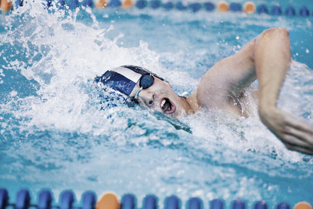 male professional competitive swimmer in swimming pool Banco de Imagens